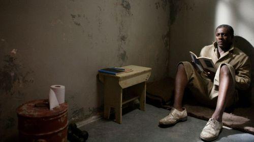 Idris Elba as the imprisoned Nelson Mandela