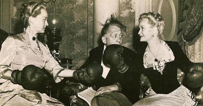 "Director Edmund Goulding refereees a catfight bewteen Bette Davis and Miriam Hopkins during the filming of ""The Old Maid"""
