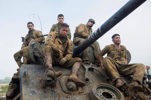 Brad Pitt (foreground) and tank crew (left to right): Shia LeBouf, ** , Michael Pena, I*.