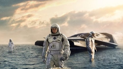 Matthew McConaughey (center) and colleagues explore a water planet