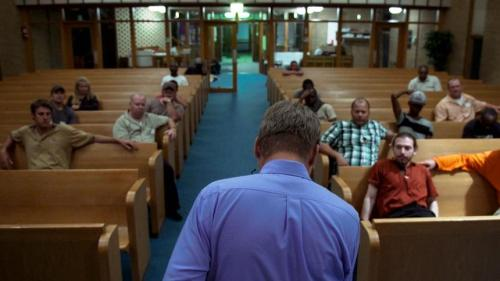 "A church filled with homeless men in ""Overnighters"""