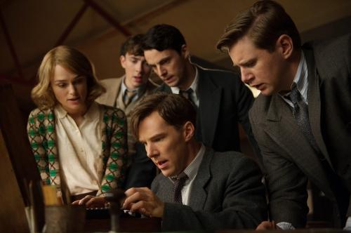 Benedict Cumberbatch (center) as Alan Touring; Kiera Knightly at left