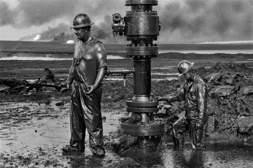 Workers extinguishing oil well fires in the wake of the first Gulf War