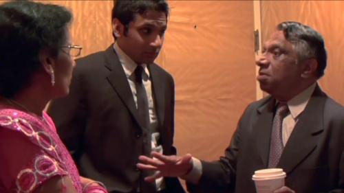 Ravi Patel (center) with mother and father