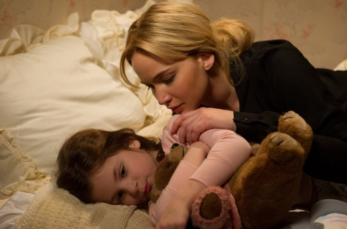 Joy (Jennifer Lawrence) comforts her daughter, Christy, in JOY.