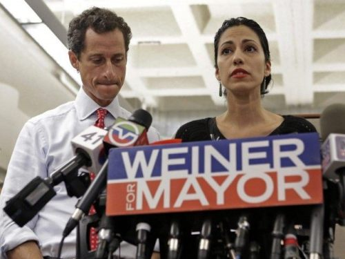 Disgraced: Anthony Weiner and his wife, Huma Abedin